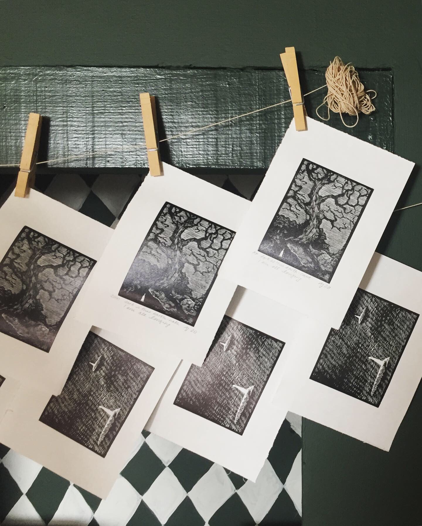 Wood engravings hanging on clothes line